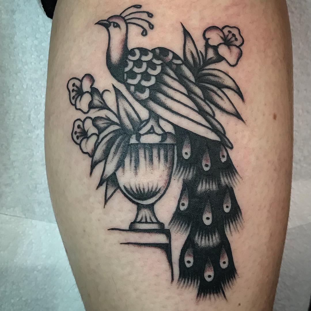Bird in vase with foliage tattoo