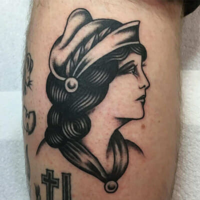 Black and white ladies head looking away tattoo