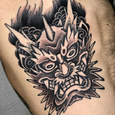 Black And Grey Dragon Head Tattoo