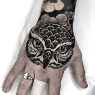Black And Grey Owl On Hand Tattoo