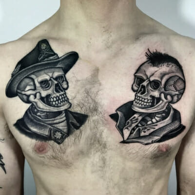 Black And Grey Skulls Chestpiece Tattoos