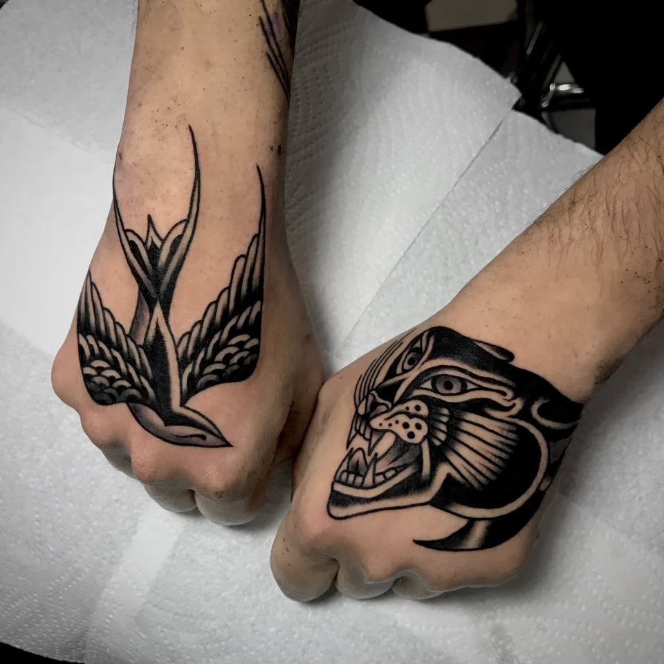 Traditional Black And Grey Swallow And Panther Hand Tattoos