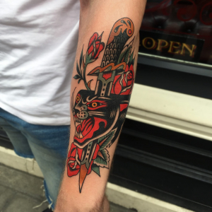 Traditional Panther And Dagger Tattoo
