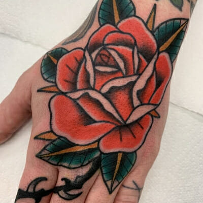 Traditional Rose On Hand Tattoo