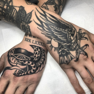 Traditional Snake And Eagle Hand Tattoos