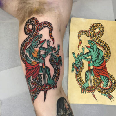 Traditional Snake And Frogs Tattoo