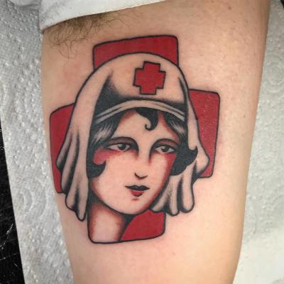 Nurses face on red cross tattoo