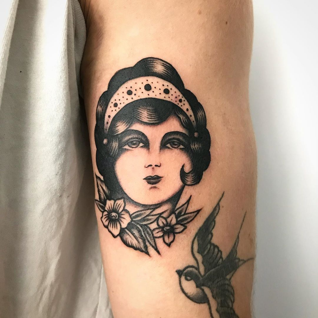 Woman face small tattoo