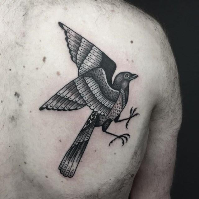 black and grey bird tattoo 05