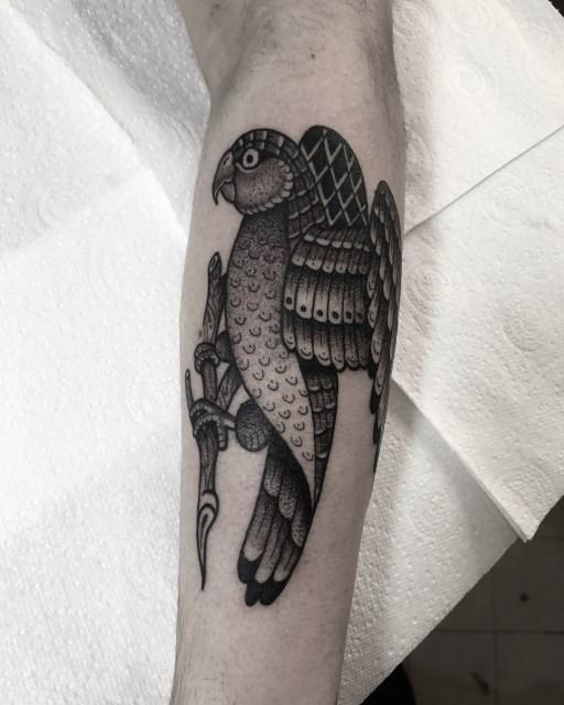 black and grey bird tattoo 11