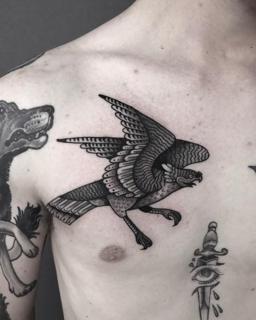 black and grey bird tattoo 12