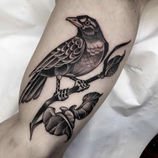 black and grey bird tattoo 22