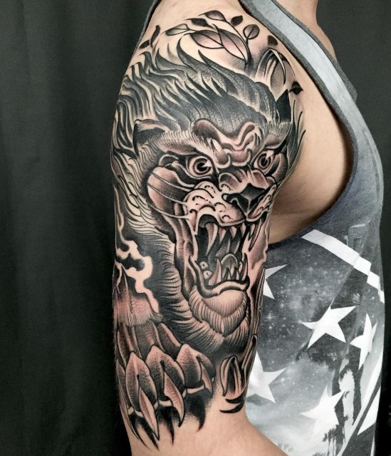 black and grey lion tattoo 1