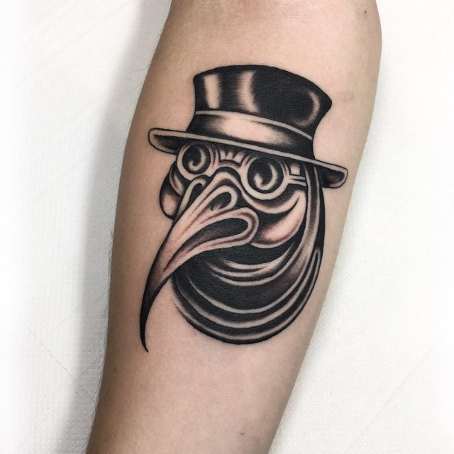 black and grey plague doctor tattoo 1
