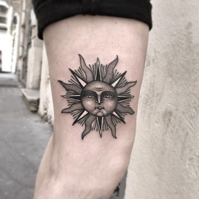 black and grey sun tattoo 1