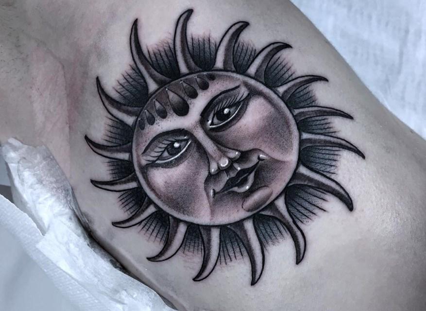 black and grey sun tattoo 2