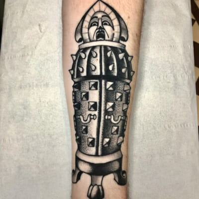 Black And Grey Trapped Tattoo