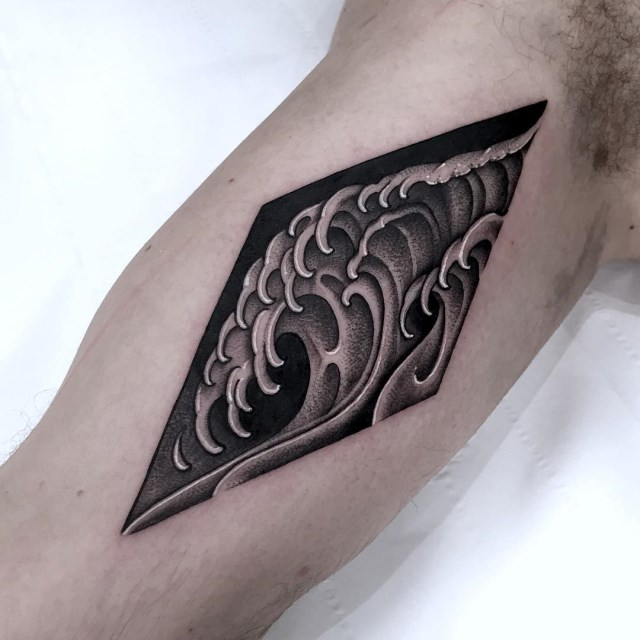 black and grey wave tattoo 1