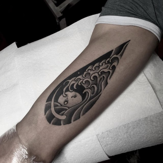 black and grey wave tattoo 3