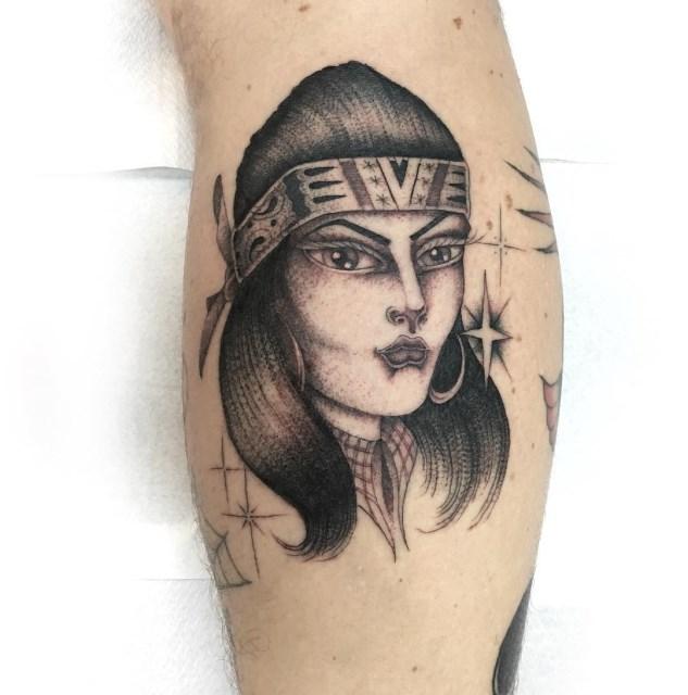 black and grey woman tattoo 14