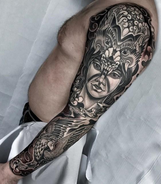 black and grey woman tattoo 19