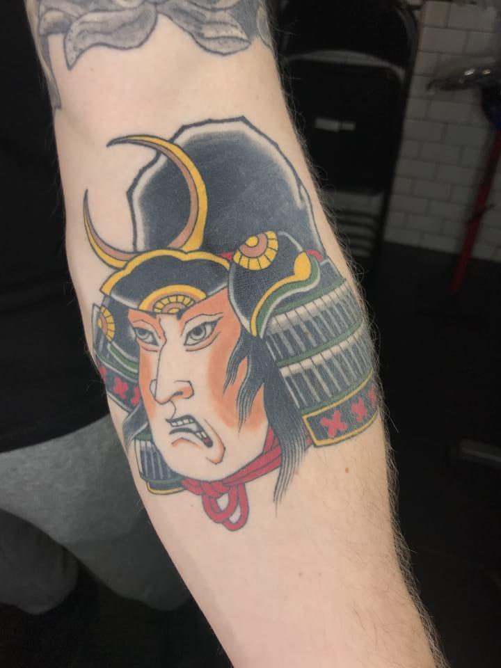 Healed Samuari Head Tattoo