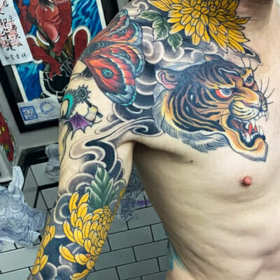 Sleeve To Chest Tattoo